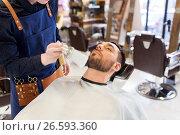 Купить «barber cleaning male face with brush at barbershop», фото № 26593360, снято 6 апреля 2017 г. (c) Syda Productions / Фотобанк Лори