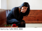 Купить «crying woman with red rose at funeral in church», фото № 26593388, снято 20 марта 2017 г. (c) Syda Productions / Фотобанк Лори