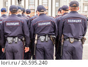 "Купить «Russian police unit in uniform on the Kuibyshev square in summer day. Text in russian: ""Police""», фото № 26595240, снято 20 мая 2016 г. (c) FotograFF / Фотобанк Лори"