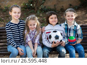 Купить «Kids posing together with ball», фото № 26595448, снято 20 июня 2018 г. (c) Яков Филимонов / Фотобанк Лори