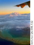 Купить «Polynesia. The atoll in ocean through clouds. Aerial view.», фото № 26598132, снято 17 июня 2011 г. (c) Куликов Константин / Фотобанк Лори