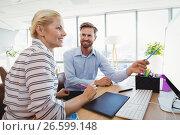 Купить «Smiling executives discussing over personal computer at desk», фото № 26599148, снято 5 марта 2017 г. (c) Wavebreak Media / Фотобанк Лори
