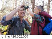 Купить «Low angle view of father and son with binoculars», фото № 26602000, снято 2 марта 2017 г. (c) Wavebreak Media / Фотобанк Лори