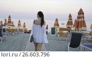 Купить «Young woman enjoying vacation on the beach in european vacation on the seashore», видеоролик № 26603796, снято 21 июня 2017 г. (c) Дмитрий Травников / Фотобанк Лори