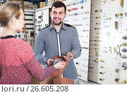 Купить «attentive male seller assisting woman in choosing door handles in shop», фото № 26605208, снято 5 апреля 2017 г. (c) Яков Филимонов / Фотобанк Лори