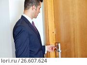 Купить «businessman with keycard at hotel or office door», фото № 26607624, снято 22 мая 2017 г. (c) Syda Productions / Фотобанк Лори