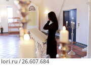 woman with wipe crying at funeral in church. Стоковое фото, фотограф Syda Productions / Фотобанк Лори