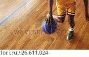 Купить «Basketball player practicing dribbling drill», видеоролик № 26611024, снято 20 июня 2019 г. (c) Wavebreak Media / Фотобанк Лори