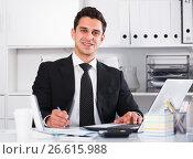 Купить «Respectable and cheerful businessman in office», фото № 26615988, снято 20 апреля 2017 г. (c) Яков Филимонов / Фотобанк Лори