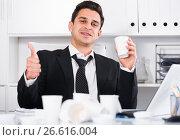 Купить «Relaxed businessman finishing work», фото № 26616004, снято 20 апреля 2017 г. (c) Яков Филимонов / Фотобанк Лори