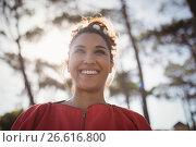 Купить «Low angle view of thoughtful smiling young woman», фото № 26616800, снято 9 марта 2017 г. (c) Wavebreak Media / Фотобанк Лори