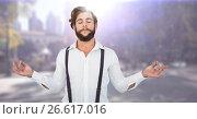 Купить «Millennial man meditating against blurry street with flares», фото № 26617016, снято 19 марта 2019 г. (c) Wavebreak Media / Фотобанк Лори