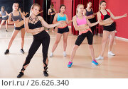Купить «Ordinary active females exercising dance moves», фото № 26626340, снято 31 мая 2017 г. (c) Яков Филимонов / Фотобанк Лори
