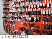 Купить «Locksmith stand with car keys on hooks», фото № 26632788, снято 17 июля 2018 г. (c) Яков Филимонов / Фотобанк Лори