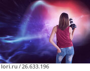 Купить «Photograph holding camera against colorful background», фото № 26633196, снято 7 июля 2020 г. (c) Wavebreak Media / Фотобанк Лори