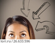 Купить «Top of woman's head looking up at downward arrows against brown background», фото № 26633596, снято 10 апреля 2020 г. (c) Wavebreak Media / Фотобанк Лори
