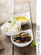 Купить «Olive oil, olives and mozzarella in bowls», фото № 26637420, снято 2 сентября 2016 г. (c) Елена Веселова / Фотобанк Лори