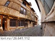 Купить «Narrow cobblestone paved street with old houses», фото № 26641112, снято 24 сентября 2016 г. (c) Сергей Новиков / Фотобанк Лори