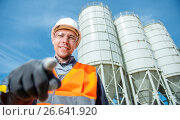 Купить «worker cement plant», фото № 26641920, снято 8 июня 2017 г. (c) Mark Agnor / Фотобанк Лори