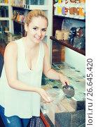 Купить «Young woman selecting various cereals», фото № 26645420, снято 24 января 2020 г. (c) Яков Филимонов / Фотобанк Лори
