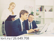Купить «Two adult business male and woman in firm office», фото № 26649708, снято 31 мая 2020 г. (c) Яков Филимонов / Фотобанк Лори
