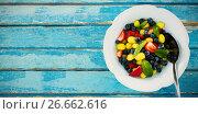 Купить «Fresh salad in bowl on blue wooden table», фото № 26662616, снято 18 июня 2019 г. (c) Wavebreak Media / Фотобанк Лори