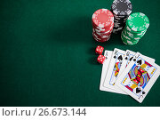 Купить «Playing cards, dices and casino chips on poker table», фото № 26673144, снято 6 апреля 2017 г. (c) Wavebreak Media / Фотобанк Лори