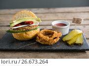 Купить «Close up of food with burger on slate», фото № 26673264, снято 13 января 2017 г. (c) Wavebreak Media / Фотобанк Лори