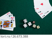Купить «Playing cards and dices on poker table», фото № 26673388, снято 6 апреля 2017 г. (c) Wavebreak Media / Фотобанк Лори