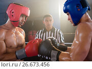 Купить «Referee looking at male boxers punching gloves», фото № 26673456, снято 22 января 2017 г. (c) Wavebreak Media / Фотобанк Лори
