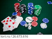 Купить «Playing cards, dices and casino chips on poker table», фото № 26673616, снято 6 апреля 2017 г. (c) Wavebreak Media / Фотобанк Лори