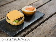 Купить «Cheese and meat with buns on slate», фото № 26674256, снято 13 января 2017 г. (c) Wavebreak Media / Фотобанк Лори