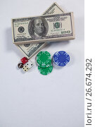 Купить «US dollars, dice and casino chips on white background», фото № 26674292, снято 6 апреля 2017 г. (c) Wavebreak Media / Фотобанк Лори