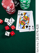 Купить «Playing cards, dices and casino chips on poker table», фото № 26674428, снято 6 апреля 2017 г. (c) Wavebreak Media / Фотобанк Лори