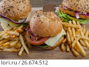 Купить «Various hamburger with tag and french fries on wooden table», фото № 26674512, снято 13 января 2017 г. (c) Wavebreak Media / Фотобанк Лори