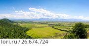 Купить «Panoramic view of the Alazani valley from the height of the hill. Kakheti region», фото № 26674724, снято 21 марта 2019 г. (c) Mikhail Starodubov / Фотобанк Лори