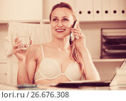 Купить «Female working in bra», фото № 26676308, снято 24 апреля 2017 г. (c) Яков Филимонов / Фотобанк Лори