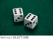 Купить «Pair of dice on poker table», фото № 26677048, снято 6 апреля 2017 г. (c) Wavebreak Media / Фотобанк Лори