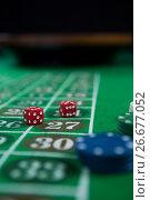 Купить «Close-up of dices and chips», фото № 26677052, снято 6 апреля 2017 г. (c) Wavebreak Media / Фотобанк Лори