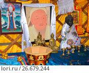 Купить «Портрет Чингисхана и предметы буддийского культа в музее ойрат-монгольской кочевой культуры. Элиста, Калмыкия», фото № 26679244, снято 22 апреля 2017 г. (c) Ирина Борсученко / Фотобанк Лори