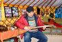 Калмыцкий мужчина играет на домбре  в помещении музея ойрат-монгольской кочевой культуры. Элиста, Калмыкия, фото № 26679392, снято 22 апреля 2017 г. (c) Ирина Борсученко / Фотобанк Лори