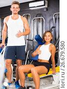 Купить «man and woman fitness coaches in gym», фото № 26679580, снято 4 октября 2016 г. (c) Яков Филимонов / Фотобанк Лори