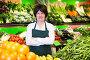 Portrait of adult female selling fruits and vegetables, фото № 26679588, снято 10 марта 2017 г. (c) Яков Филимонов / Фотобанк Лори