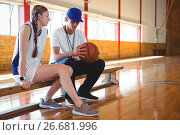 Купить «Coach talking with female basketball player», фото № 26681996, снято 18 февраля 2017 г. (c) Wavebreak Media / Фотобанк Лори