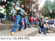 Купить «Portland, Oregon: Tusitala â. œTinyâ.Toese, a member of Warriors for Freedom, performs a customary dance at the Trump Free Speech Rally Portland. Organized...», фото № 26684452, снято 22 мая 2019 г. (c) age Fotostock / Фотобанк Лори