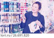 Купить «Woman choosing mouline for embroidery in needlework shop», фото № 26691820, снято 10 мая 2017 г. (c) Яков Филимонов / Фотобанк Лори
