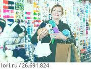 Купить «Woman with accessories for needlework», фото № 26691824, снято 10 мая 2017 г. (c) Яков Филимонов / Фотобанк Лори