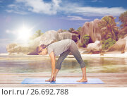 Купить «woman making yoga intense stretch pose on beach», фото № 26692788, снято 13 ноября 2015 г. (c) Syda Productions / Фотобанк Лори