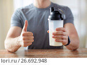 Купить «man with protein food showing thumbs up», фото № 26692948, снято 14 мая 2015 г. (c) Syda Productions / Фотобанк Лори