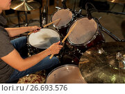 Купить «male musician playing drums and cymbals at concert», фото № 26693576, снято 18 августа 2016 г. (c) Syda Productions / Фотобанк Лори